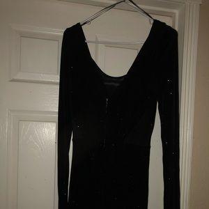 A guess dress it a black shiny dress